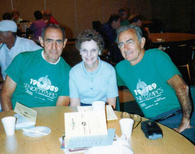 Charlie Kurtz, right, and his brother, William Kurz (different spelling), left, played ping pong in Senior Olympics competition in 1989. Seated between them is Charlie's wife, Polly.