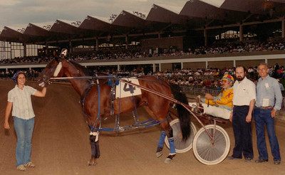 Charlie Kurtz, far right, owned, bred, boarded and trained horses for harness racing, including Greenacres Johnny, shown after winning a race at Scioto Downs in this 1983 Barry E. Conrad photo.