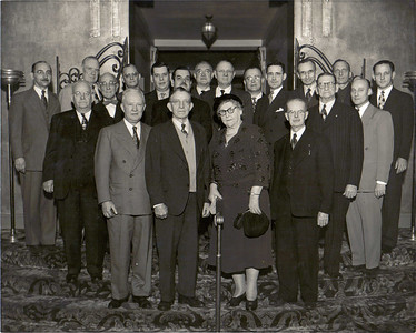Charlie Kurtz's aunt, Marie Sly, the only woman in this 1952 photo, took over the W. W. Sly Co. after her husband, Wilfred C. Sly, was killed by payroll robbers on Dec. 31, 1920.