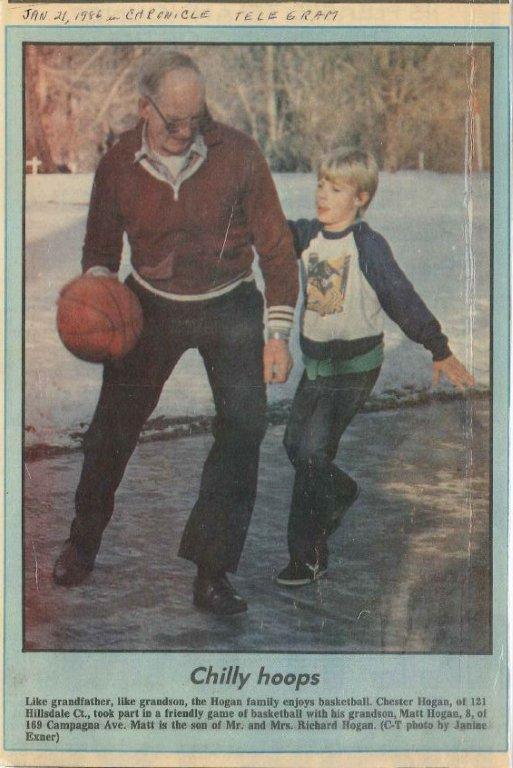 Chet Hogan plays basketball with his grandson, Matt, in 1996. (Chronicle-Telegram photo provided by the family.)