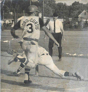 Chet Hogan, a member of the Elyria Umpires Association for 29 years, judges action at first base. (Provided by the family.)