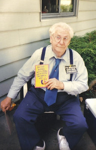 """At a birthday celebration in recent years, Clarence Talcott sports a tag that says """"I've survived damn near everything."""" (Photo courtesy of the family.)"""