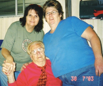 Clarence Talcott in 2003 with his daughters Maureen Stipe (left) and Suzanne Runals (right). (Photo courtesy of the family.)