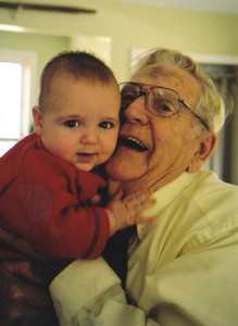 Clarence Talcott lavishes affection on his first great-grandchild, Tristin Stipe. (Photo courtesy of the family.)