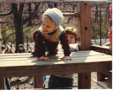 Craig Behrend, 1 ½, tests out playground equipment at the Cleveland Metroparks Zoo in April 1985.