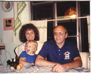 Craig Behrend, pictured at age 2 ½ with his parents, Betty and Ernie Behrend, in 1986.