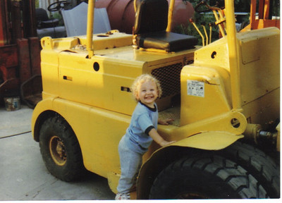 Craig Behrend, 2, gets ready to try out his uncle's forklift.