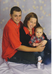 Craig Behrend, his wife, Casie, and their son, Mark, then 1 ½, posed for this family portrait in December 2007.