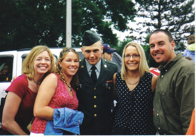 Craig Behrend, center, is flanked by his sister Brenda Behrend and his then-girlfriend Casie Moran, on the left, and his sister Cindy Zanny and her husband, Chuck, in June 2003.