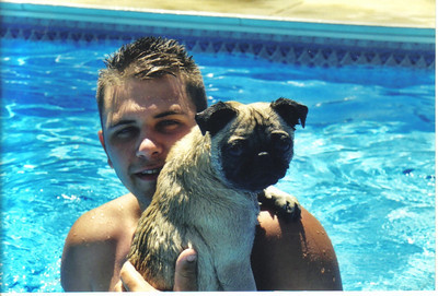 Craig Behrend swims with Riley the pug in 2003.