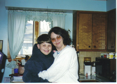 Craig Behrend and his mom, Betty, hug in the kitchen when he was around 10.