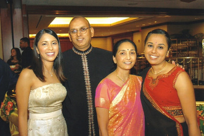 The Patel family at daughter's wedding reception in 2006. From left, the bride Rachna Patel Fruchbom, D.C., Minal and Rakhee.