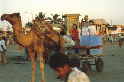 The Patel family takes a camel cart ride in Mumbai in 1987.