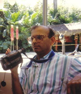 D.C. Patel, shown in the Bahamas, took hundreds of pictures and hours of video footage from his travels to share with family and friends.