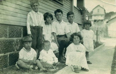 Dan Brattoli, standing on the left, is pictured with seven of his 10 siblings in New Lexington, Ohio. (Photo courtesy of the family.)