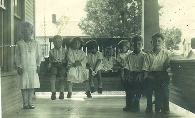 Dan Brattoli, second from the left and seated on the swing, was one of 11 siblings raised in New Lexington, Ohio. Most of them are pictures with him here. (Photo courtesy of the family.)