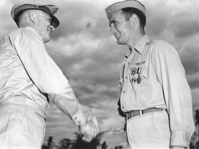 Dan Brattoli, right, is congratulated by then Lt. General George C. Kenney, who presented him with the Distinguished Flying Cross and Air Medal during World War II. A short time after this photo was taken, Kenney was promoted to full general, making him one of only four airmen to hold that rank during the war. (Photo courtesy of the family.)
