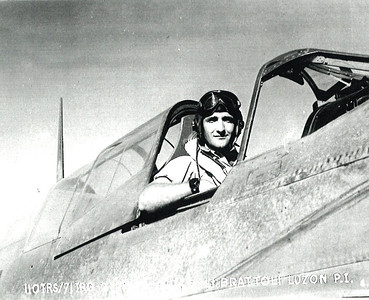 """Dan Brattoli, seated in his Warhawk in 1945, found a fierce opponent in the Japanese during World War II. """"He never showed an animosity toward anybody during his life,"""" his son, Daniel D., said. """"He never showed bitterness after the war, which I think is commendable considering what he went through."""" (Photo courtesy of the family.)"""