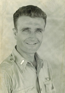 """Dan Brattoli, pictured March 1945 in the Philippines, never lost his interest in flight. """"When they had air shows at Lorain County airport, and they were living on West Ridge, dad could identify the type of plain by the sound without seeing the planes,"""" his daughter Mary said. (Photo courtesy of the family.)"""