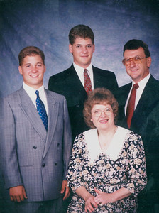 Slaughenhaupt family portrait, 1990s: Dixie, seated. Behind her are sons John, left, and Jim Jr., center, and husband, Jim Sr., right.