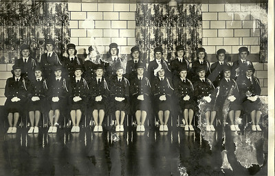 Eleanor Malinowski (seated second from the right) belonged to the Polish Legion of American Veterans Post 38 Drill Team. Her sister Irene is standing directly behind her, and her sister Helen is to her right. (Photo courtesy of the family.)