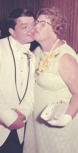 Eva Mae Pugh plants a kiss on her son, Michael, at his wedding in 1970.