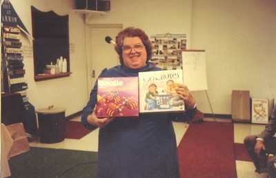 Eva Mae Pugh shows off a couple of games that she received from Tupperware.