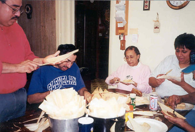 Guadalupe Flores, in pink, and several of her offspring gather around the kitchen table for the Flores family's pre-Christmas tradition: Making tamales for the holiday. (Photo courtesy of the family.)