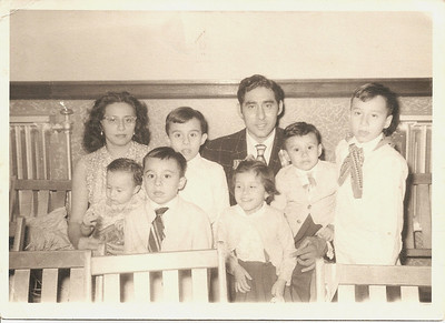 Partial Flores family portrait. From the left, Guadalupe Flores holding Jaime, David wearing tie, Jorge, Pete (a.k.a. Dad), Esperanza in front of him, Carlos and Pete Jr. (Photo courtesy of family.)