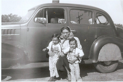 Guadalupe Flores with her sons Pete Jr. and Jorge. (Photo courtesy of the family.)