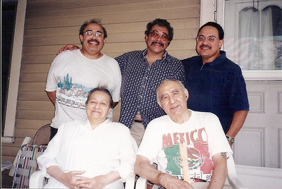 Sons Jorge, Carlos, and Martin stand behind their parents, Guadalupe and Pete Flores. (Photo courtesy of the family.)