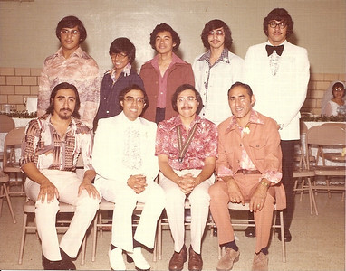 Pete Flores, seated far right, his sons and a son-in-law. Standing from the left are son-in-law Fermin Rosalez and sons, Jose, Martin,Jaime and Carlos; seated from the left are: Sons David, Jorge and Pete Jr. The bride in the background is Gloria, Jorge's wife.(Photo courtesy of the family.)