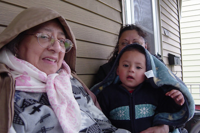Guadalupe Flores, foreground, her daughter, Hope, a.k.a. Esperanza, whose face is hidden by little Rodrigo, Hope's grandson and Guadalupe's great-grandson. (Photo courtesy of the family.)