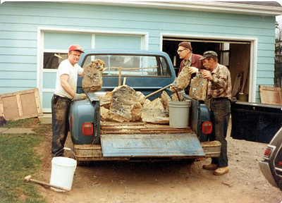 Frannie, Ted Adams and George Steffan show slabs of Ohio flint they brought back from Flint Ridge in Licking County.