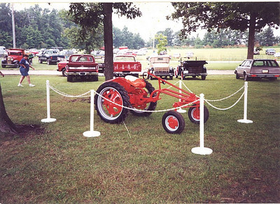 """Frannie Grim's sons Scott and Jeff restored his Allis Chalmers """"G"""" tractor, which was exhibited at the Medina County Fair."""