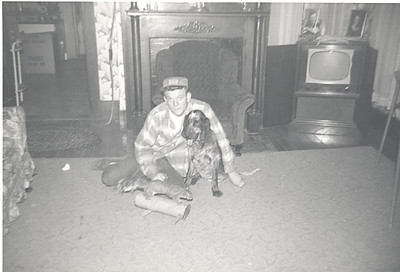 Frannie Grim and his coondog Mort in 1958.