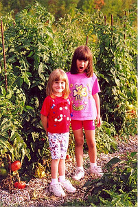 Frannie Grim's granddaughters Lauren and Arika McGraw pose in their grandfather's garden in 1997.