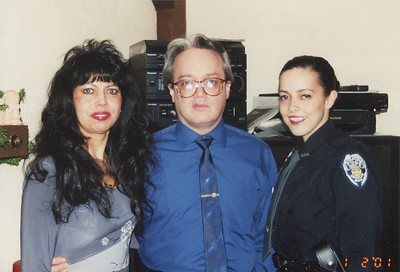 Iris and Fred Morales pose with their daughter, Julie, while she was serving with the Oberlin Police in 2001. (Photo courtesy of the family.)