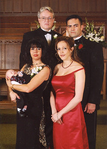Morales family portrait, taken at Will's wedding in 2004: Back row, left to right, Fred and his son, Will; Front row left, Fred's wife, Iris, holding grandson, Gage Reynolds, and right, daughter, Julie. (Photo courtesy of the family.)