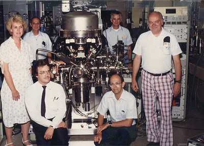 "Wilfredo ""Fred"" Morales, front left, and some NASA colleagues pose with their surface analytic instrument in 1989. Among the many space exploration topics Fred studied as a NASA engineer was the use of land vehicles on the surface of Mars under the planet's extreme climate conditions. (NASA photo courtesy of the family.)"