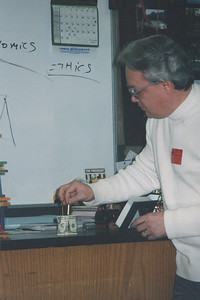 Fred Morales performs a scientific experiment for students. (Photo courtesy of the family.)