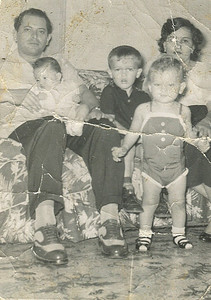 Gonzalez family, late 1950s: Fred Morales' parents, Antonio and Aida Gonzalez, with Fred, center, his baby sister, Evelyn, in his father's arms, and his sister, Liz, standing. Fred was so young when his biological father died that he could not remember him.  Antonio Gonzalez was the only father Fred ever knew. (Photo courtesy of the family.)