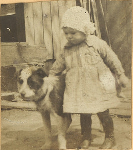 Geneva Willis as a toddler makes friends with a scruffy dog. (Photo courtesy of the family.)