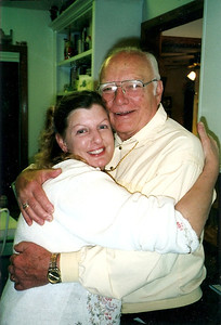 George Hoover gets a hug from his daughter, Robin. (Photo courtesy of the family.)