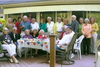 Bobbie Hoover's 85th birthday celebration at home in Oberlin. Bobbie is seated on the far left. George is standing, 6th from the right, in a yellow sweater. (Photo courtesy of the family.)