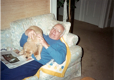 George Hoover takes a nap with Kody, his daughter Robin's dog, in the 1980s. (Photo courtesy of the family.)