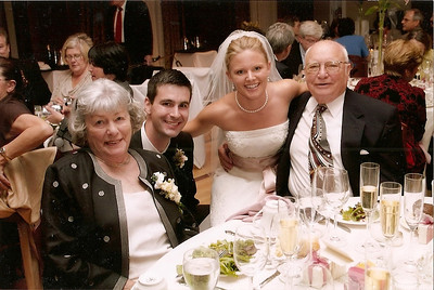 Bobbie and George Hoover celebrate the wedding of granddaughter, Natalie, to Rick Roby, in 2006. (Photo courtesy of the family.)