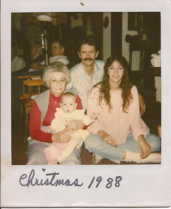 Harris Opfer, back, celebrates Christmas 1988 with his mother, Ruth, left, his granddaughter, Kara, (in Ruth's arms) and daughter, Christine, right. (Photo courtesy of the family.)