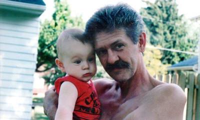 Harris Opfer holds his grandson, Daniel. (Photo courtesy of the family.)