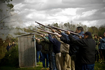 Several of Harris Opfer's fellow muzzleloader shooting friends provide a 21-gun salute as a final farewell to him on Oct. 15, 2011. (Photo courtesy of the family.)